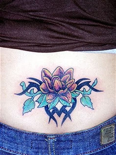cover up lower back tribal tattoo dollkemprot lower back cover up