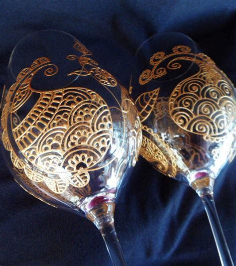 henna design on glass wine glasses hand painted with henna from mehndiglass on etsy