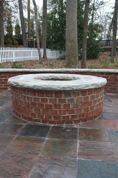 Red Brick Firepit With Stone Cap Fireplaces And Firepits Firepit Bricks