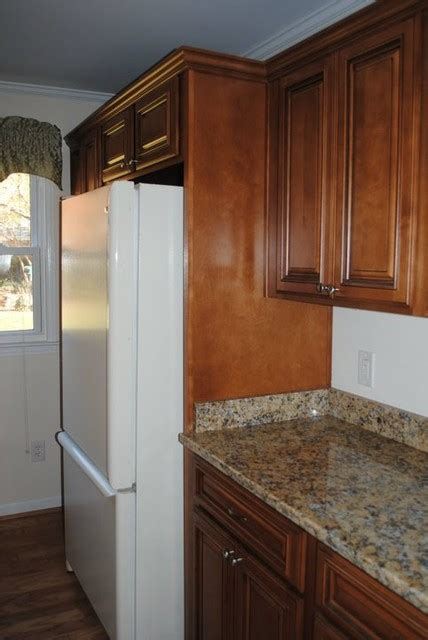 refrigerators that take cabinet panels deep cabinet above the refrigerator and a wood panel on