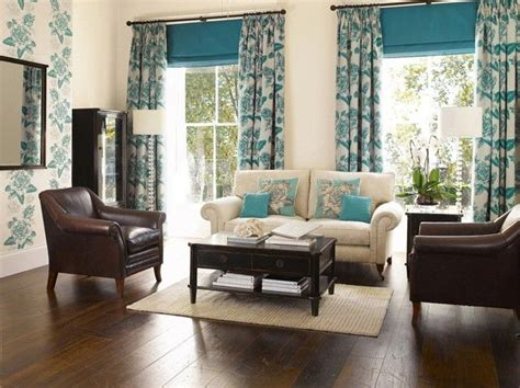cream living room curtains this living room design features dark stained floors and