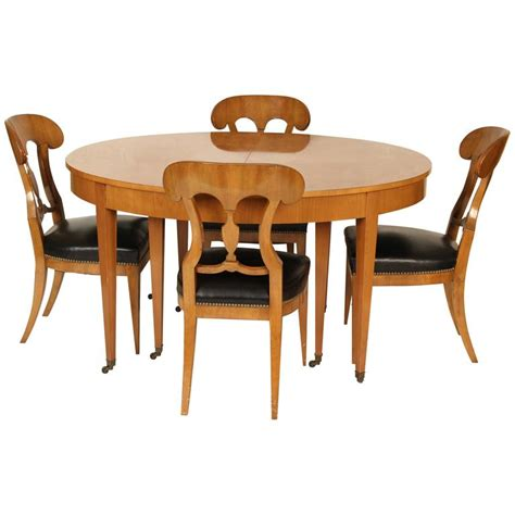 biedermeier style dining table by baker and four chairs at
