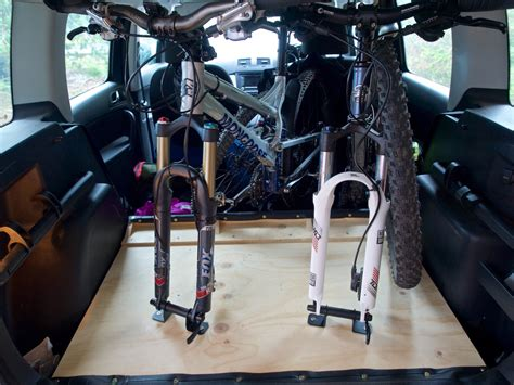 skoda yeti inside 2 bikes inside a skoda yeti with the spare tyre and half