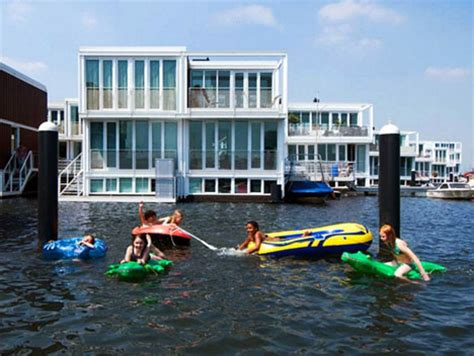 dutch house boat 75 prefab floating homes form a houseboat town in holland
