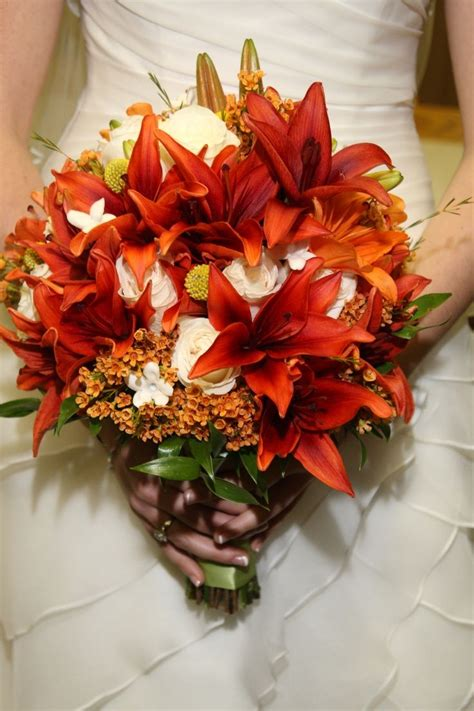 burnt orange wedding bouquets s fall bouquet burnt orange lilies and ivory autumn