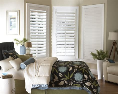 contemporary bedspread with plantation shutters