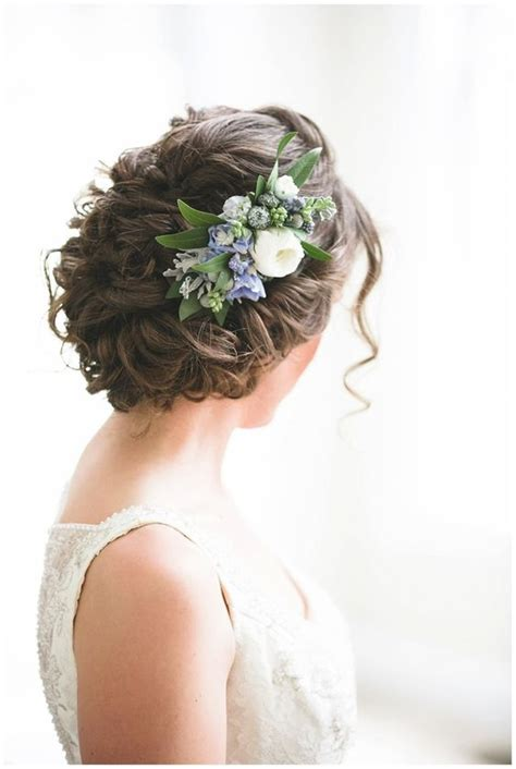 picture of curly updo with fresh blue flowers for
