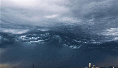 storm chaser captures mesmerizing time lapse  clouds