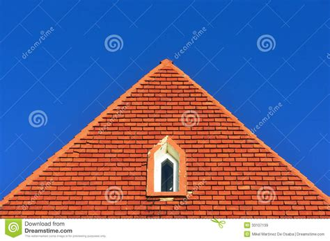 Triangle Shaped Roof Window In A Roof Attic With Bricks Royalty Free Stock