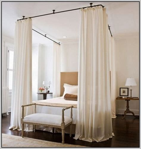 hanging bed curtains from ceiling curtain rods hang from the ceiling to simulate a canopy