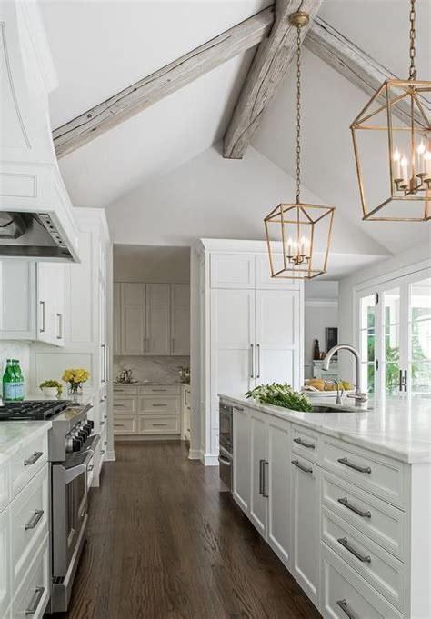 Kitchen Ceilings With Beams by Chic Kitchen Boasts A Gray Vaulted Ceiling Adorned With
