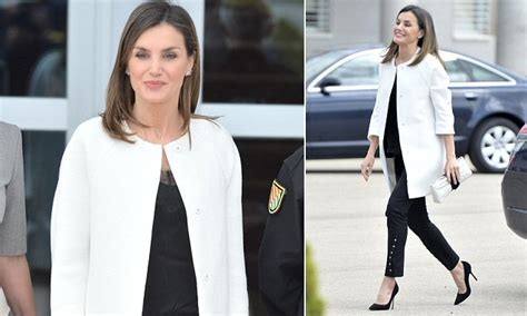 queen letizia is chic in white as she welcomes panamas queen letizia of spain looks chic in black and white in madrid