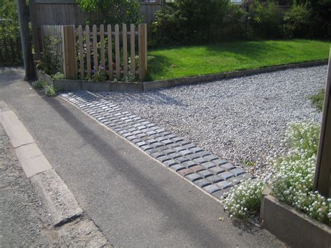 driveway entrance showing a rumble strip retaining the gravel house pinterest driveway