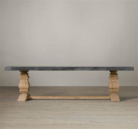 trestle dining table with a concrete top from restoration