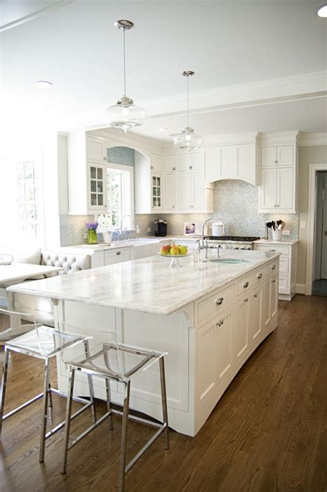 mystery island kitchen the peak of tr 232 s chic white kitchens marble vs quartzite