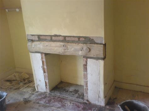the of a timber lintel and plastering of a
