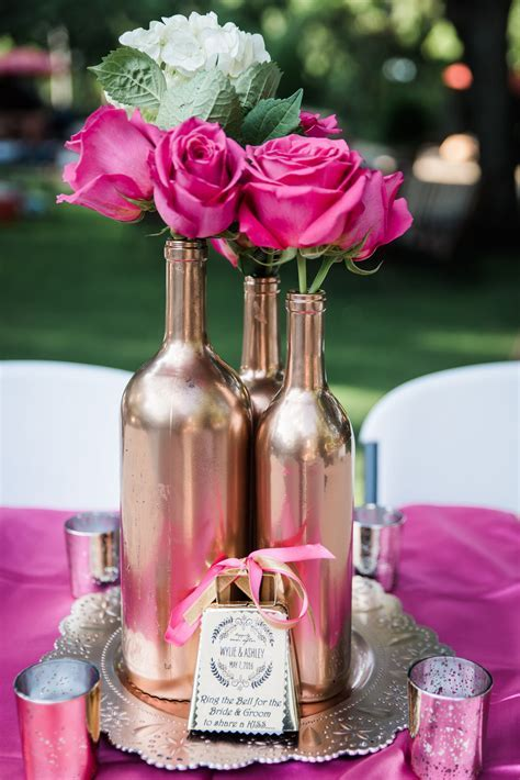 Hot pink roses and white hydrangeas. Rose Gold Wine bottle