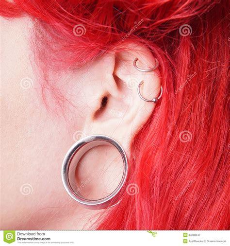 female ear lobes flesh tunnel stock image image of earring alternative