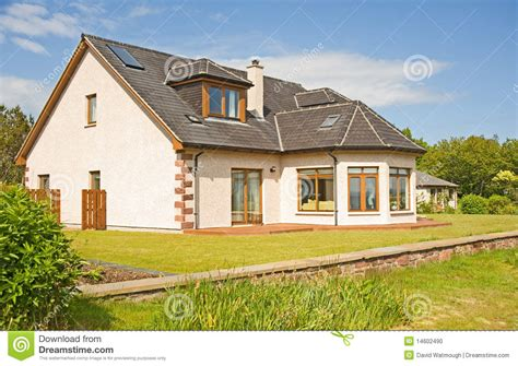 modern house with chimney and garden stock photo image