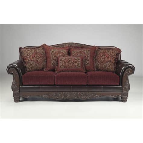 ashley faux leather sofa ashley weslynn place faux leather sofa in burgundy 8240238
