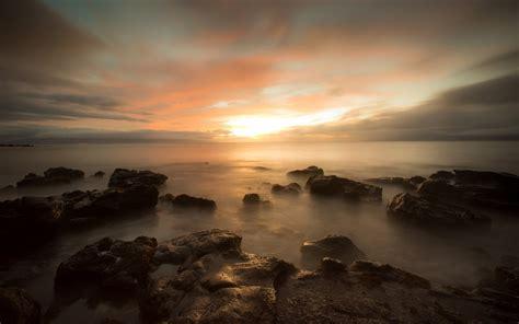nature sea water stones horizon sky sunset clouds night