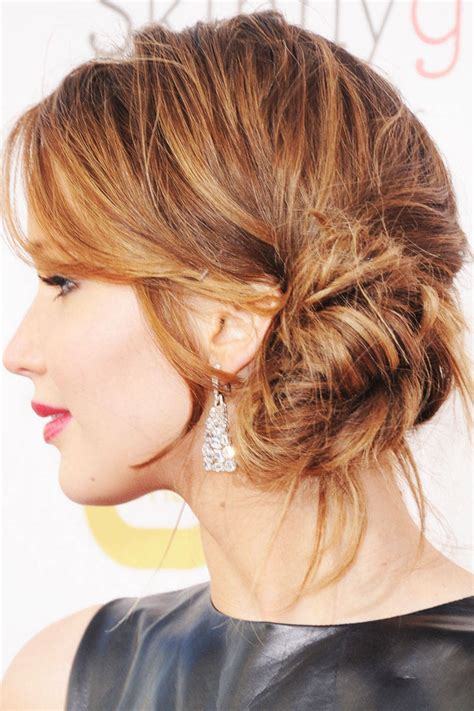 low hight hair make elegant low messy side bun with long hair