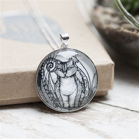 cheshire cat silver necklace and glass pendant by