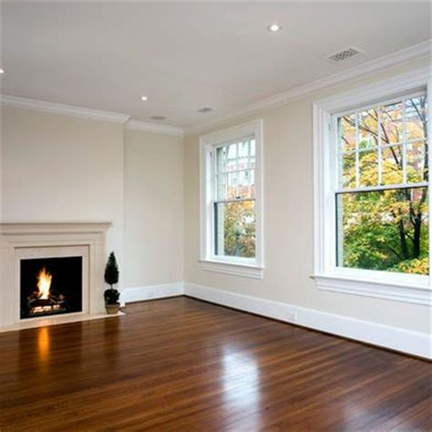 antique white walls white ceiling and trim medium wood floor fireplace of how ours