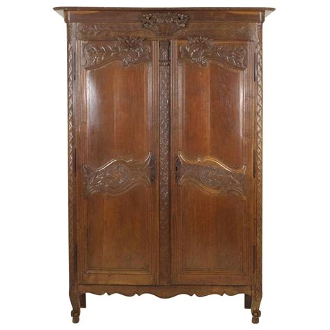french antique armoire antique french normandy marriage armoire wardrobe 1840 at 1stdibs