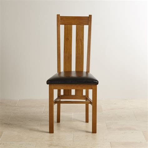 Rustic Leather Dining Chairs Arched Back Dining Chair In Rustic Solid Oak Black Leather