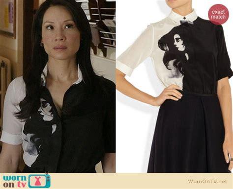 Joan Watson Wardrobe by Wornontv Joan S Black And White Dress With Girl S