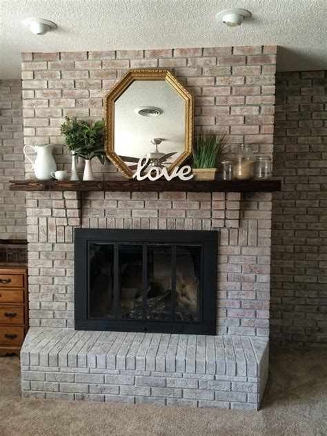 the crux grey paint wash on a brick fireplace before after