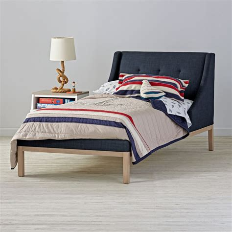 navy beds gallery navy upholstered wing bed the land of nod