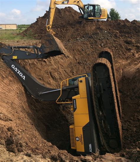 dozer accident trackhoe accident excavator fell into hole two