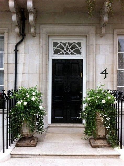 black door matching urns and ivy front doors pinterest