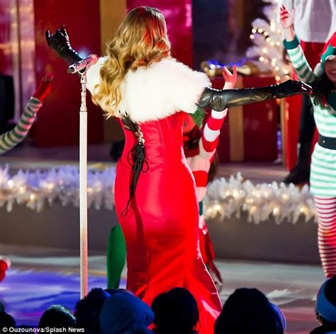 mariah carey red and white dress and tree lighting on