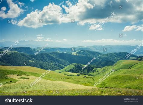 summer mountains green grass and blue sky landscape stock