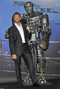 film robot boxing hugh jackman punches wrestler as he crashes wwe match to