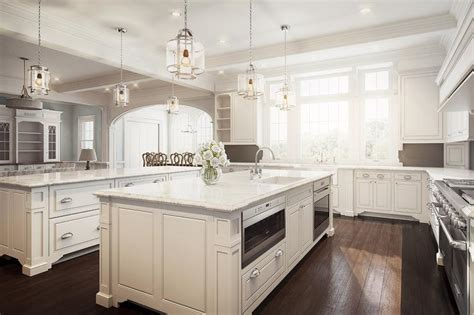 white and brown kitchen with two islands transitional