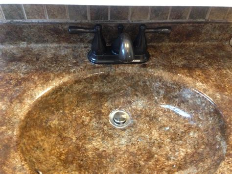 sponge painted bathroom sink and rubbed bronze spray