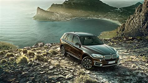 bmw mountain full hd wallpaper bmw x5 mountain crossover rock top view