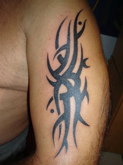 outstanding tribal arm tattoo designs for 2011 men tribal