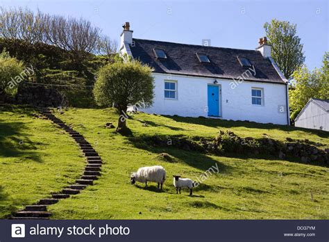 white scottish highland croft cottage with blue door and