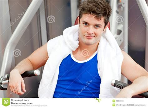 towel bench press confident young man with a towel using bench press stock