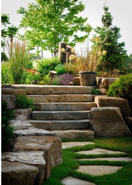 hardscaping wide flat stone steps medium sized boulders