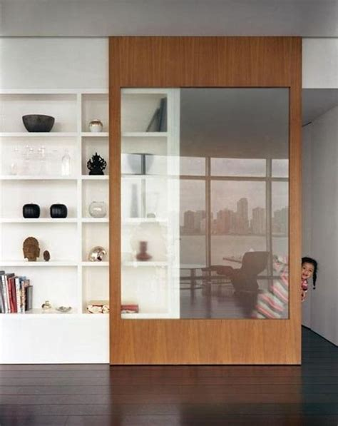 sliding bookcase door sliding bookcase door made out of light colored wood interessante interieurs
