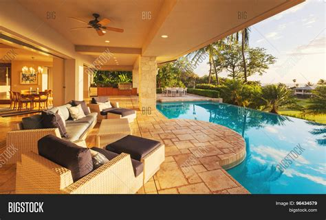 luxury home plans with pools beautiful luxury home with swimming pool at sunset stock