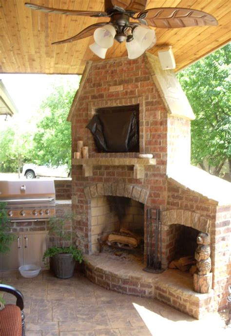 outdoor fireplace and grill now that s an awesome corner