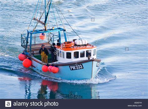 fishing boat uk fishermen in a blue fishing boat trawler padstow north
