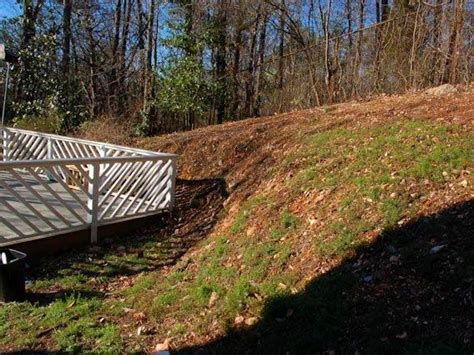 sloped backyard before and after how to landscape a sloping backyard diy